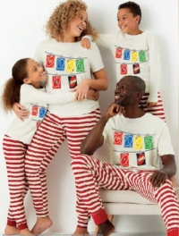 Family in UNO Christmas PJs